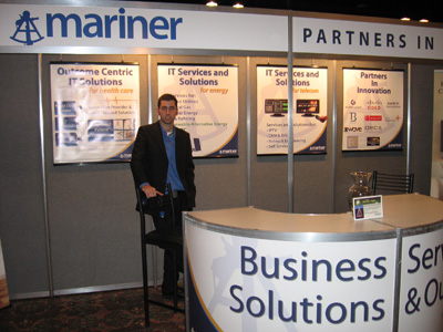 Jarett Nickerson standing in front of the Mariner Booth at the 2009 Think NB tradeshow