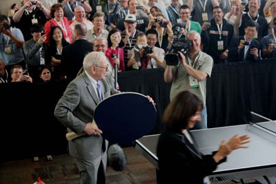 Multibillionaire Warren Buffett, chairman of conglomerate Berkshire Hathaway, relaxes by playing a game of ping pong after the company's 2010 annual shareholders meeting