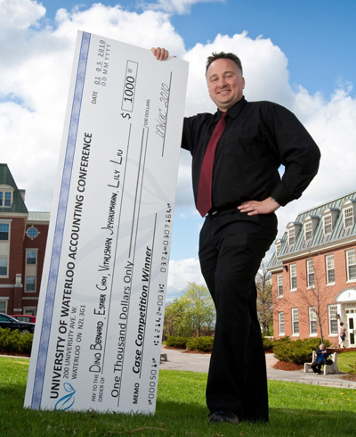 Dino Bernard with the $1,000 top prize cheque from UWAC 2010