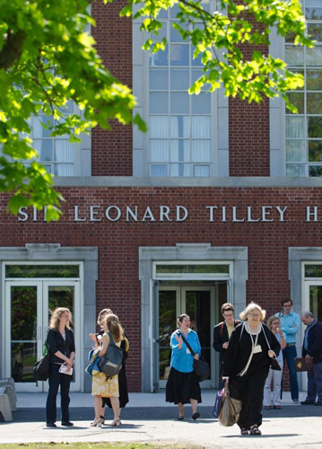 Delegates of Congress 2011 coming and going in front of Tilley Hall