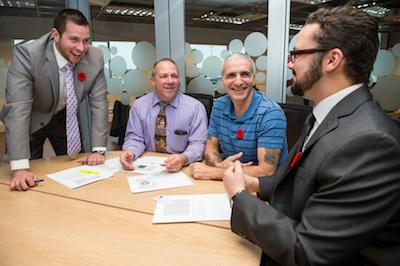 MBA students Elliot Thompson (extreme left) and Zachary Robson (extreme right), consulting with two retiring members of the Canadian Armed Forces on their business plans.