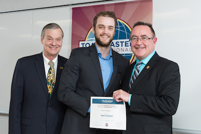 Duncan McCormick (centre) receives the Speechcraft certificate from then Mayor of Fredericton Brad Woodside (L) and Toastmasters International President Jim Kokocki (R).