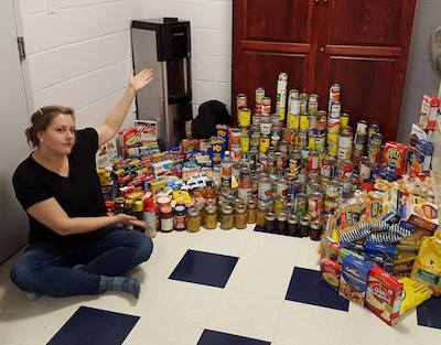 Fourth year BBA student Meghan Harper championed a food drive among students at UNB.