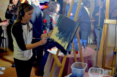 Artists participating in the fundraiser had 20 minutes to produce a painting with guests voting for their favourite at the end of each round.