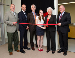 From left to right: Anthony Secco (vice-president Fredericton), Stephen Acker (son), Jamie Acker (son), Sydney Acker (granddaughter), Doe Acker (widow), and David Coleman (dean of engineering)