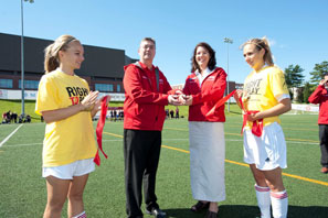 Meggie Spicer, women's soccer player and BMO soccer award recipient; Eddy Campbell, UNB president; Christine Cooper, vice-president, New Brunswick and PEI, BMO; and Emily Sarty, women's soccer player and BMO soccer award recipient.