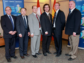 from left to right: ACOA Minister Bernard Valcourt; Dr. Weichang Du, P.Eng., Professor, Faculty of Computer Science, University of New Brunswick; Dr. Yun Zhang, P.Eng., Professor, Canada Research Chair in Advanced Geomatics Imaging Processing, Department of Geodesy and Geomatics Engineering, University of New Brunswick; Felipe Chibante, Associate Professor Department of Chemical Engineering, University of New Brunswick;; Marc St-Hilaire, Vice-President, Advanced Technology and Innovation, CAE Inc.; and Minister of Fisheries and Oceans and Minister for the Atlantic Gateway Keith Ashfield.