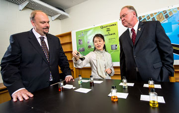 UNB's newest CRC recipient, Ying Zheng (centre), shows David Burns, vice-president research at UNB (left); and Minister Keith Ashfield, Member of Parliament for Fredericton (right) her research lab.