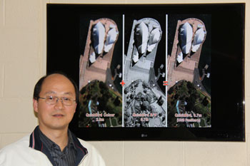 Dr. Yun Zhang is seen here standing in front of a before-and-after UNB PanSharp (fusion) image. UNB PanSharp technology and its global impact is one of the main reasons for Dr. Zhang's award. The low resolution colour and the high resolution black-and-white are original images from the QuickBird satellite.  The high resolution colour image is the result produced by UNB PanSharp.