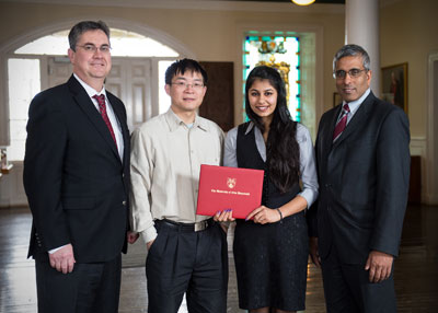 The first of many fellowship recipients was presented with a certificate of congratulations at the signing.  Left to right: Eddy Campbell, UNB President, Yonghao Ni, Director of Limerick Pulp and Paper Centre, Ishneet Kaur, Globalink Fellow, and Arvind Gupta, Mitacs CEO.
