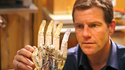 Kevin Englehart works on an artificial hand. (Brian Atkinson)