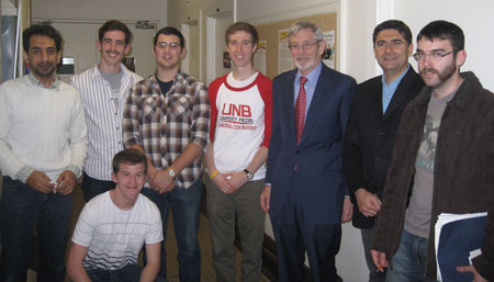 Participants from the lunch and learn speaker series event at UNB. L to R : Hassan AL-Hassawi, James Mullin, Tyler Mullin, Chris McNamara, Derek Oland, Mehrdad Kiani, Ian Fraser.  Alexander Mullin (kneeling).