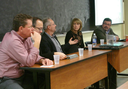 Panel members answer questions from UNB computer science students.