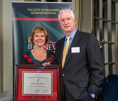 Rob Austin, Dean, presenting the 2012 Certificate of Achievement to Kim MacPherson (BBA '84), Auditor General of New Brunswick, at the 25th Business Awards Dinner