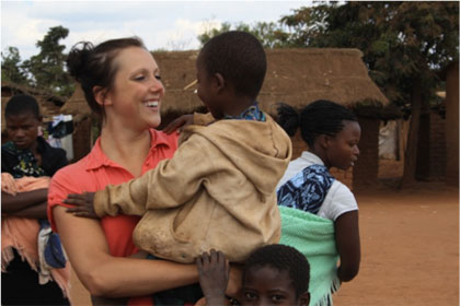 Melissa Foster (KIN) plays with children in Kauma Village, where she volunteered with Feed the Children Program.