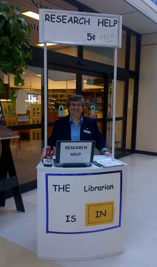 Judy MacLean is stationed at the 'Librarian is in' kiosk at the Science and Forestry Library, UNB Fredericton.