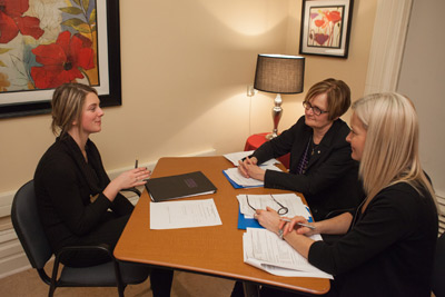 Cathlia Ward, 1st Year Renaissance College student (left) takes part in a mock interview with UNB Alumnae, Maia Deveau (right/front) and Carol Loughrey (right/back).