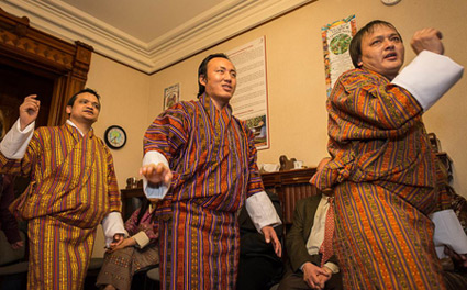 Bhutanese students, (left-Right) Rabsel Dawa, Jangchu Tenzin and Karma Phunsho, performed some traditional songs and dances at the New Years celebrations. Photography by Peter Gross.