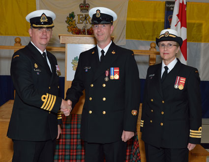 Captain (N) Dickinson, Deputy Commander Naval Reserve; CPO2 Todd Kelly, and Commander Syvertsen-Bitten, Commanding Officer HMCS Brunswicker, during the presentation of the Queen's Diamond Jubilee Medal - September 26, 2012