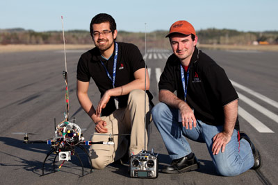Students Amr Nagaty (left) and Carl Thibault (right) represent UNB's COBRA team at 2013 UAV national competition. Photo credit: Yvon Thibault
