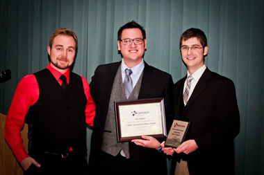 Ben Tippett accepting the 2012-13 UNB Student Union Teaching Excellence Award. He was nominated by students, Mike Bremner (pictured left) and Mitch Dionne (right).