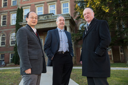 The Honourable Keith Ashfield (right) congratulates UNB's Dr. John Spray (middle) and Dr. Yun Zhang (left). (Rob Blanchard photo)