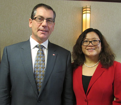 The Honourable Kevin Sorenson (left), minister of state for finance and Dr. Weiqiu Yu (right), chair of economics at the University of New Brunswick