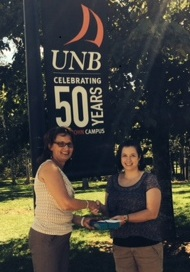 Dr. Karen Furlong, senior teaching associate at UNB Saint John presents Laura Sullivan with the iPad Mini.