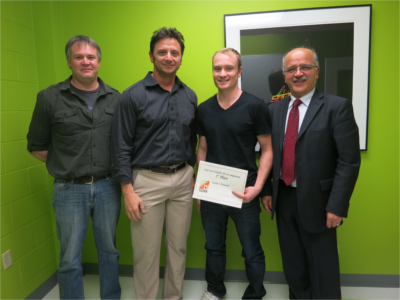 Left to right: Ryan Groom, founder of Trekkit; Mike LeBlanc, president and CEO BlueSpurs; Catlin O'Donnell, winner of CS Square Student Pitch Competition; and Ali Ghorbani, dean of UNB's faculty of computer science