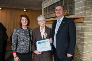 CFUW Fredericton president Sharon Crabb, Nora Ni Chuiv and UNB president Eddy Campbell.