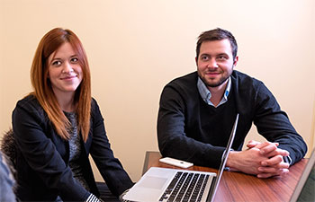 MBA candidates Joanna Nickerson and Elliot Thompson are working with entrepreneur, Melani Flanagan, co-founder of Kinderguardian, in a new course that teaches students to assess risk from the perspective of venture capitalists like the New Brunswick Innovation Foundation.