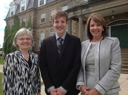 The first JDI NB Scholarship recipient, Jacob Wall, with Shirley Cleave, associate vice-president academic (learning environment) at UNB in Fredericton, left; and Colleen Baxter, vice-president human resources at JDI.