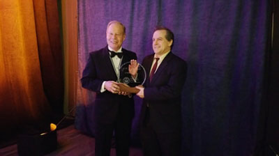 Dr. Dave Lentz (right), PGeo, accepts the L.W. Bailey Award from outgoing APEGNB President Paul Campbell, PEng (left)