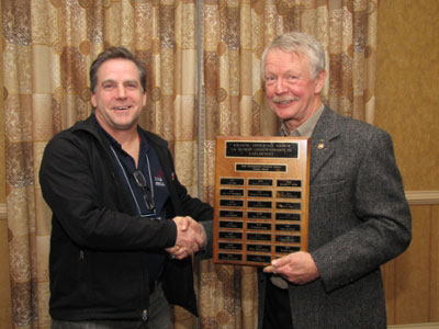 Dr. Dave Lentz (left), accepts the AGS Gesner Medal from AGS Vice-President Dr. Bob Grantham (right)