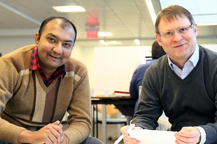Pictured, left is Ahmad Bukhari and right is Dr. Chris Baker.