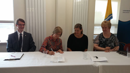 UNB vice president academic Jane Fritz signs the engineering MOU while André Samson, Université de Moncton vice president academic and research, Mary Butler, NBCC vice president academic development, and Brigitte Arsenault, CCNB vice president academic and student development, look on.