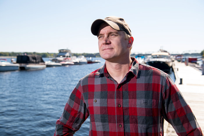 Tommi Linnansaari, a research associate with the Canadian Rivers Institute at the University of New Brunswick and the new UNB CAST Atlantic Salmon Research Chair, poses by the Saint John River in Fredericton. He will be coordinating new, innovative research projects aimed at reviving wild Atlantic salmon.